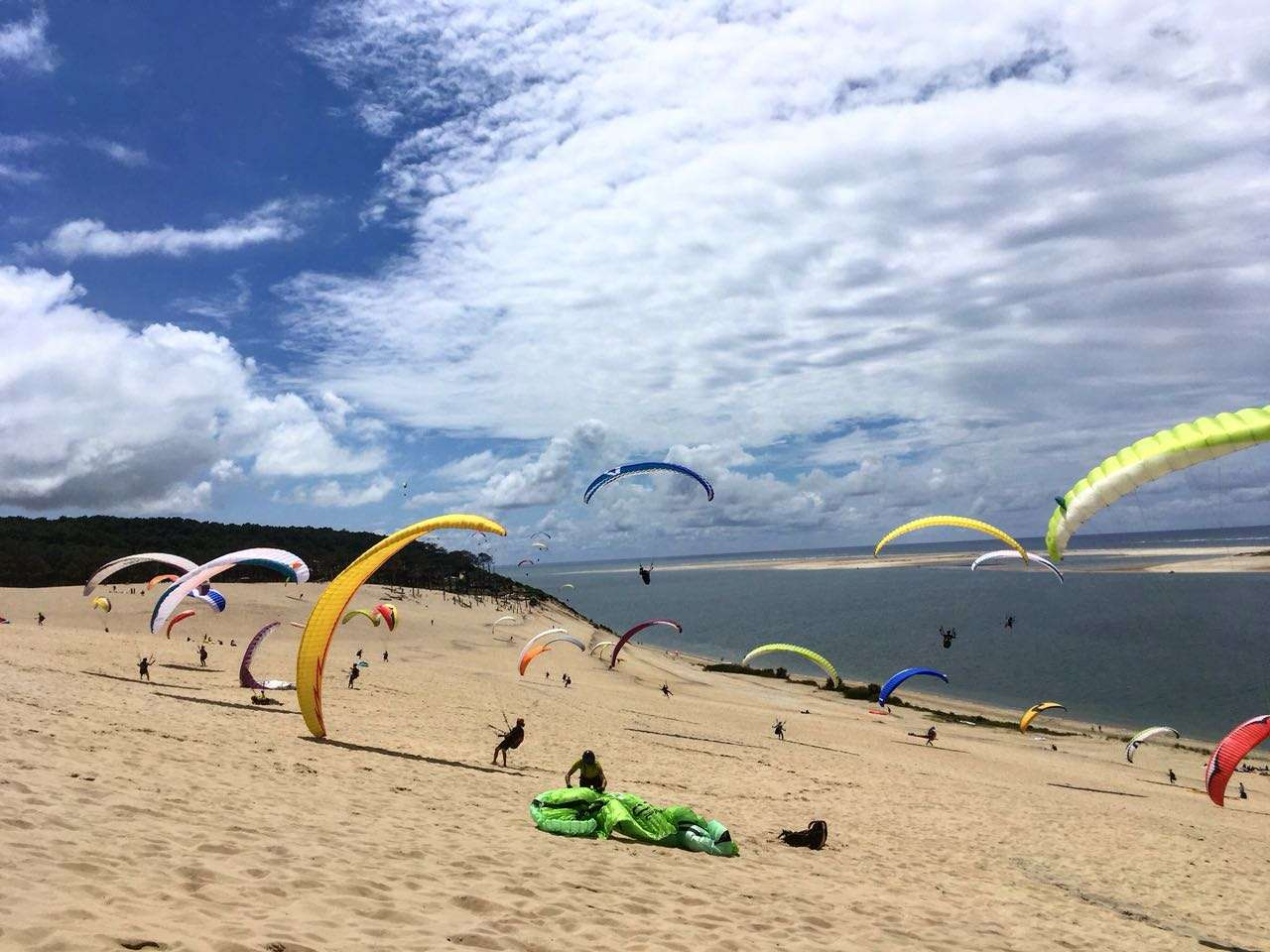 Crazy beach paragliding at Europe's most loved coastal site