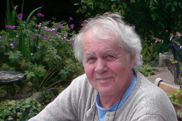 Ian Gregory in his garden in Dorset