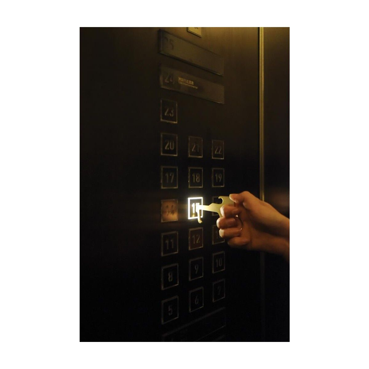 zero contact keychain used on elevator buttons